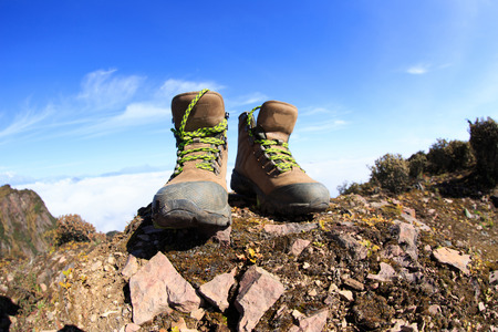 hiking boots: hiking boots on beautiful mountain peak