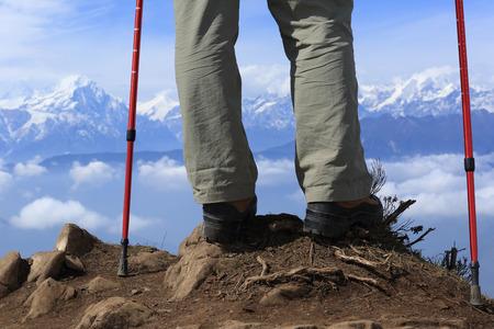 jokul: backpacker legs hiking to mountain peak Stock Photo