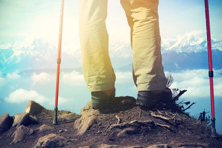 jokul: backpacker legs hiking to mountain peak,vintage effect