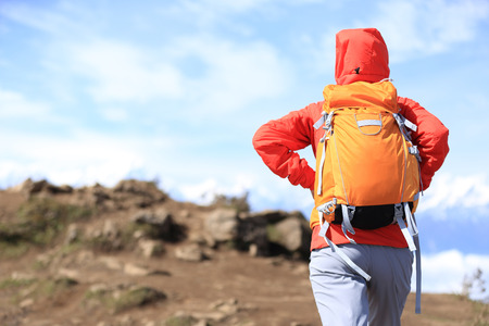 jokul: young woman hiker hiking on beautiful mountain peak