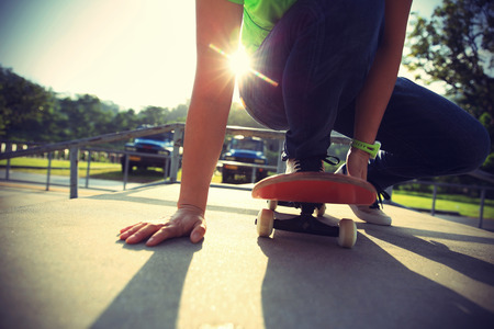 skateboard shoes: skateboarder legs  at skatepark Stock Photo