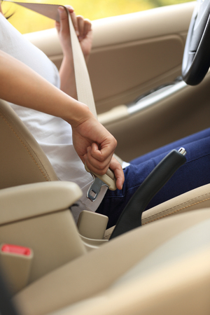 buckle: woman driver buckle up the seat belt before driving car Stock Photo