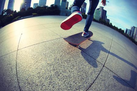 skateboard: skateboarder skateboarding at sunrise city Stock Photo