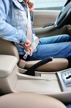 buckle: woman driver buckle up seatbelt