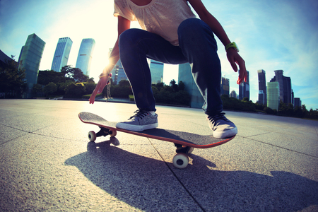 skateboarder skateboarding at sunrise city Stock Photo