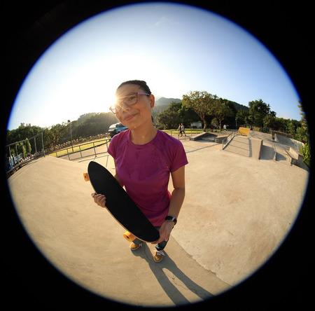 weirdo: young woman skateboarder with skateboard at skatepark Stock Photo