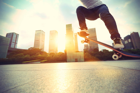 skateboard shoes: skateboarder skateboarding at sunrise city Stock Photo