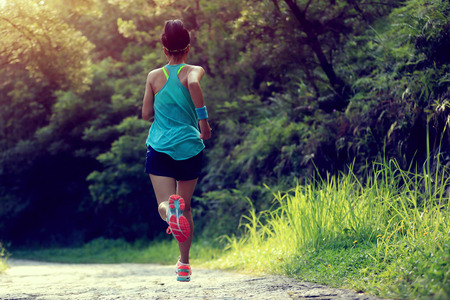 retro woman: Runner athlete running on forest trail. woman fitness jogging workout wellness concept.