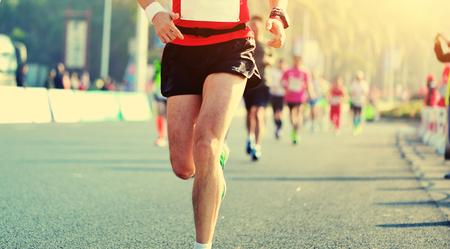 marathon running: Marathon running race, people feet on city road Stock Photo