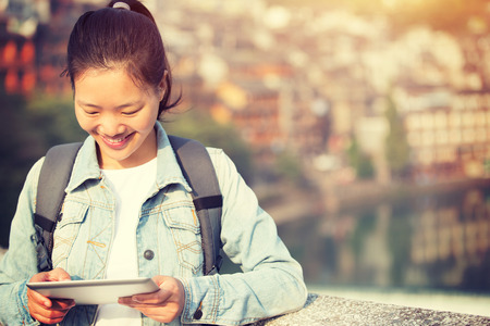 gril: young woman tourist use digital tablet