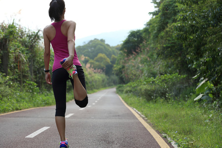 warm up: woman runner warm up outdoor