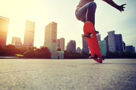 skateboard shoes: skateboarder doing skateboarding trick ollie on city