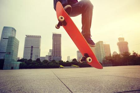 skateboard: woman skateboarder skateboarding at city