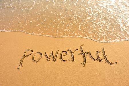 powerful: word powerful draw on beach