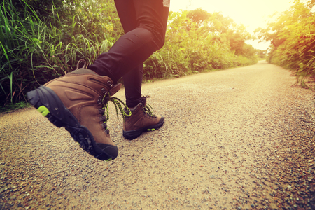 hiking boots: woman hiking on forest trail