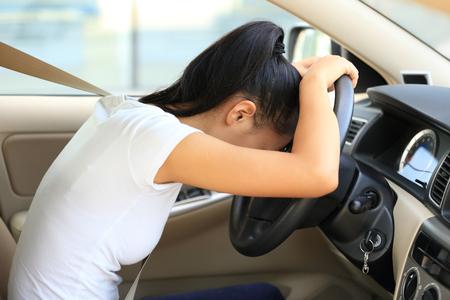 crash: sad woman driver in car Stock Photo
