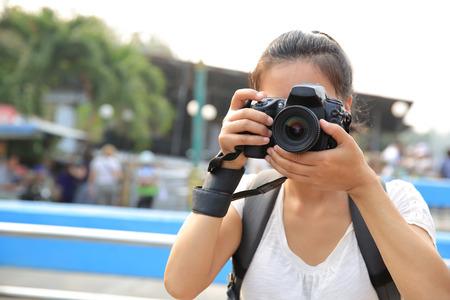 taking photo: woman tourist taking photo at Damonen saduak floating market Stock Photo