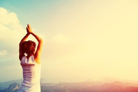 thai yoga: young yoga woman mountain peak