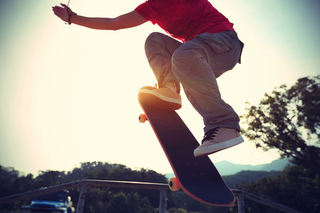 skate park: skateboarder doing a ollie at skate park