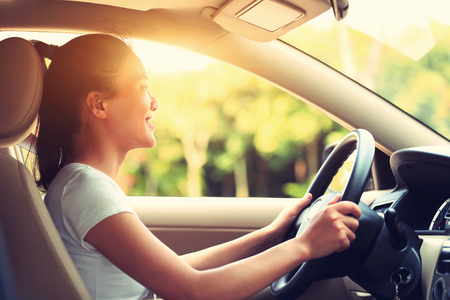 woman driving car: young asian woman driver driving a car, vintage effect Stock Photo
