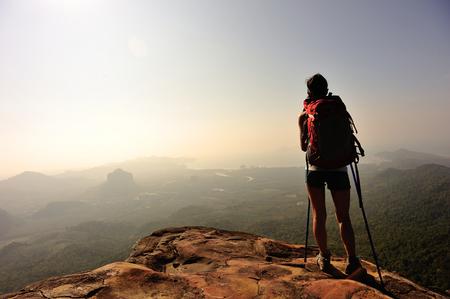 vintage woman: woman hiker enjoy the view at mountain peak Stock Photo