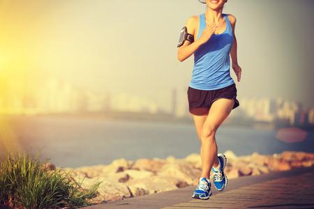 seaside: Runner athlete running at seaside city