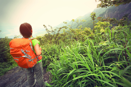 stair climber: young woman hiker enjoy the beautiful landscape at mountain peak
