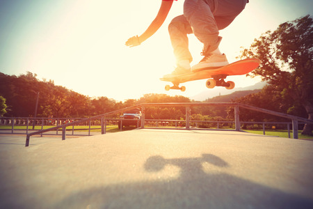 skateboard shoes: skateboarder riding skateboard at skatepark, vintage effect Stock Photo