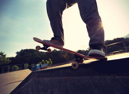 ramp: skateboarder riding skateboard at skatepark ramp Stock Photo