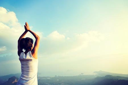 fit girl: yoga woman mountain peak