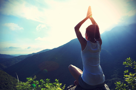 yoga rocks: young fitness woman practice yoga at mountain peak rock,vintage effect