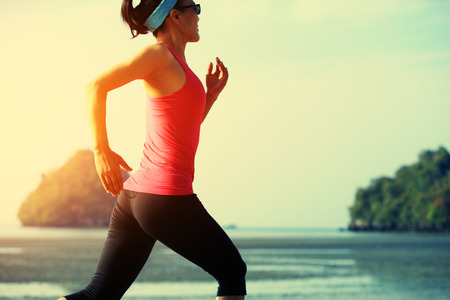 chinese people: young fitness woman running at sunrise beach