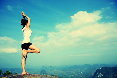 yoga rocks: yoga woman mountain peak