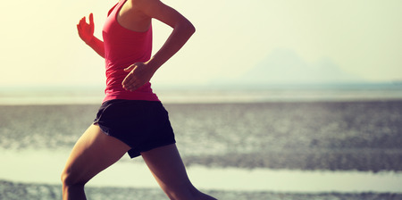 people running: young healthy lifestyle asian woman running on beach Stock Photo