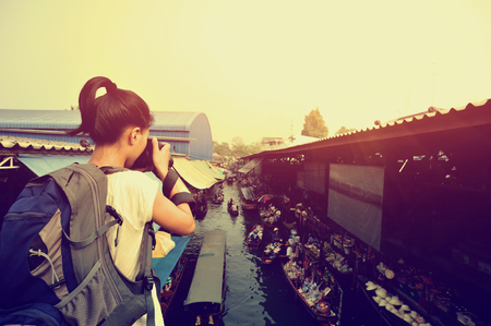 saduak: woman tourist taking photo at Damonen Saduak floating market