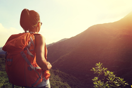 one young woman: woman backpacker on mountain peak enjoy the view