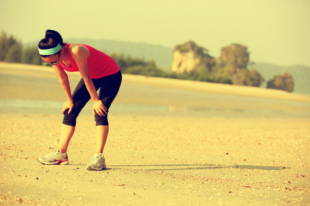 woman outdoor: tired woman after running hard at beach Stock Photo