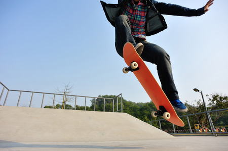 skateboard shoes: young skateboarder  skateboarding at skatepark Stock Photo