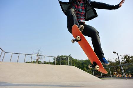 skateboard: young skateboarder  skateboarding at skatepark Stock Photo