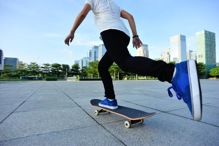 skateboard shoes: woman skateboarder legs skateboarding at  city