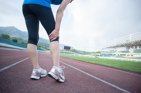 twitch: woman runner hold her injured leg on track