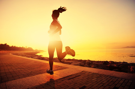 jogging: Runner athlete running at seaside.   Stock Photo