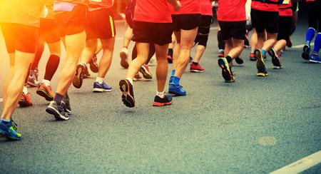 marathon runner: Marathon runners running on city road