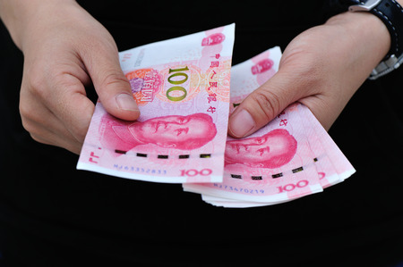 yuan: Hands with chinese yuan money