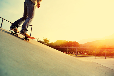 ramp: woman legs skateboarding at skatepark ramp