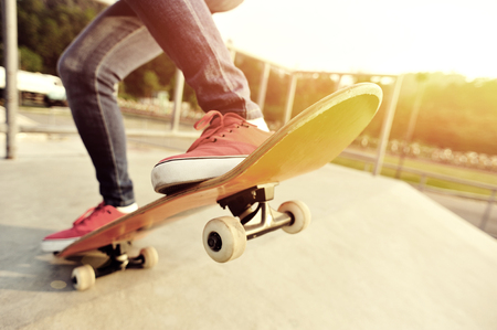 skateboard shoes: young woman legs skateboarding at skatepark
