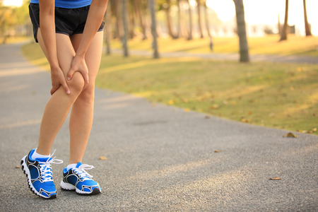 woman runner sports injured leg Banco de Imagens - 50529593