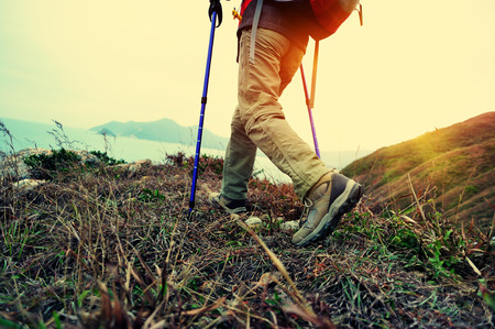 woman hiker hiking on seaside trail Stock Photo