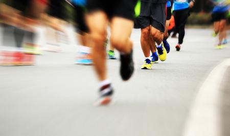 chinese people: marathon athlete legs running on city road