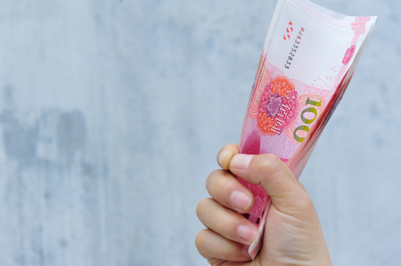 yuan: Hand with chinese yuan money Stock Photo
